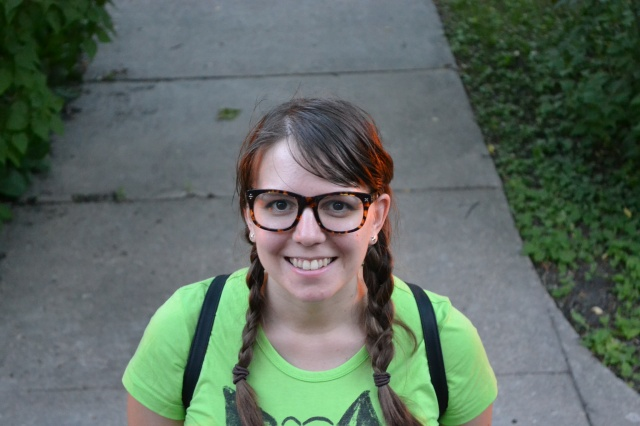 glasses, neon, t-shirt, high waisted jean shorts, mini-backpack, braids